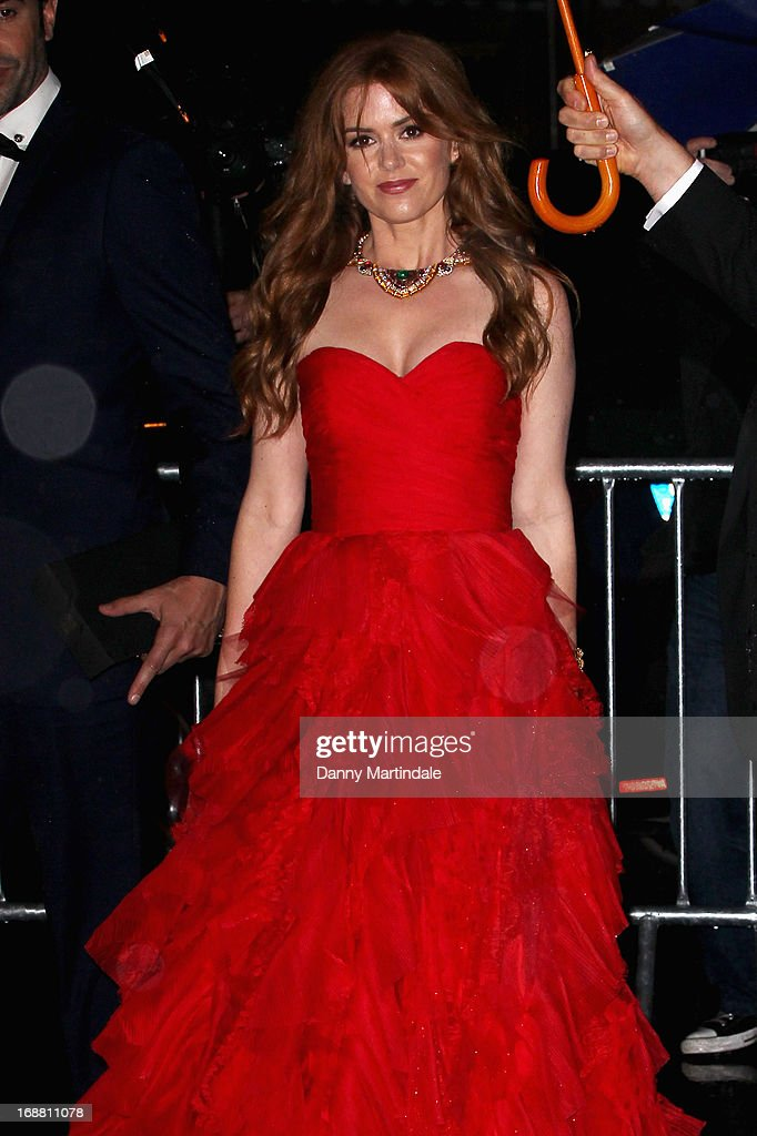 Actress Isla Fisher departs the Opening Ceremony and premiere of 'The Great Gatsby' during the 66th Annual Cannes Film Festival at Palais des Festivals on May 15, 2013 in Cannes, France.