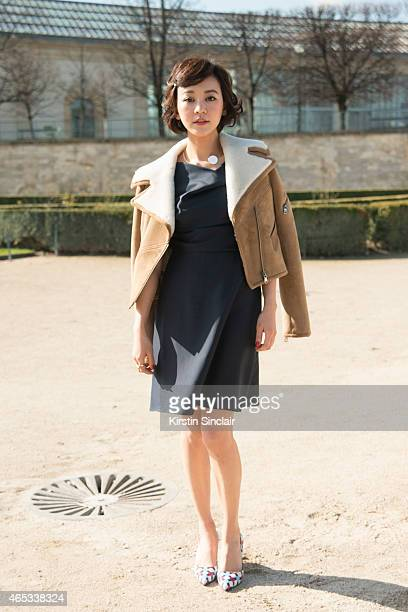 Actress Ivy Chen wears a Carven coat and dress and Roger Vivier shoes on day 3 of Paris Collections Women on March 05 2015 in Paris France