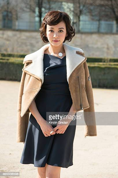 Actress Ivy Chen wears a Carven coat and dress on day 3 of Paris Collections Women on March 05 2015 in Paris France