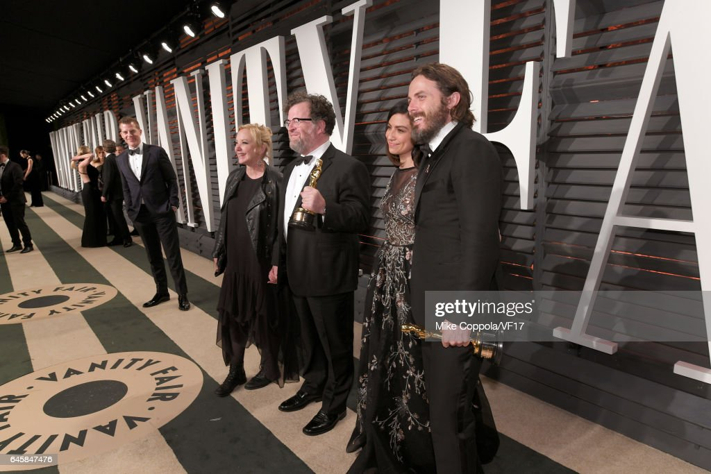 Actress J. Smith-Cameron, writer-director Kenneth Lonergan, actor Floriana Lima, and actor Casey Affleck attend the 2017 Vanity Fair Oscar Party hosted by Graydon Carter at Wallis Annenberg Center for the Performing Arts on February 26, 2017 in Beverly Hills, California.