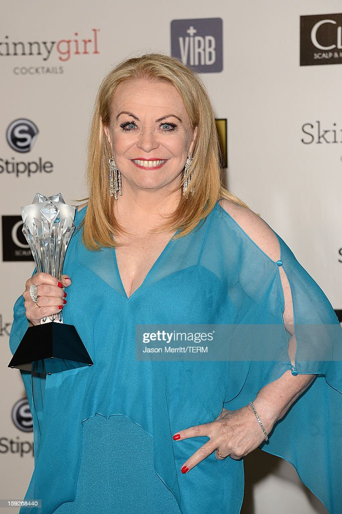 Actress Jacki Weaver of the Best Acting Ensemble-winning film 'Silver Linings Playbook,' poses in the press room at the 18th Annual Critics' Choice Movie Awards held at Barker Hangar on January 10, 2013 in Santa Monica, California.