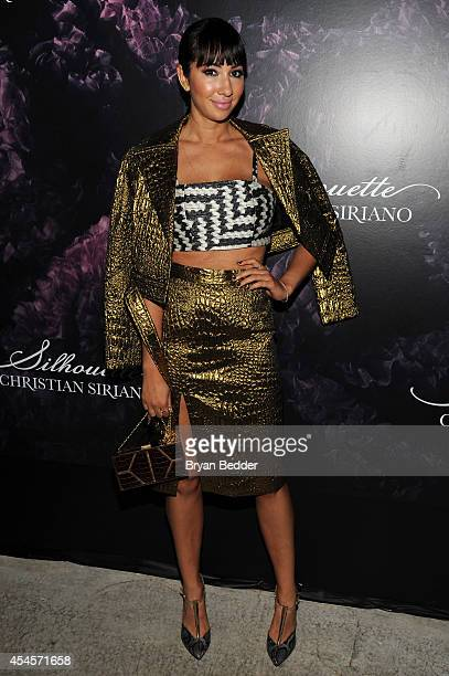 Actress Jackie Cruz attends Christian Siriano's celebration of his new fragrance with a Stoli Vodka cocktail at the designer's popup Silhouette...