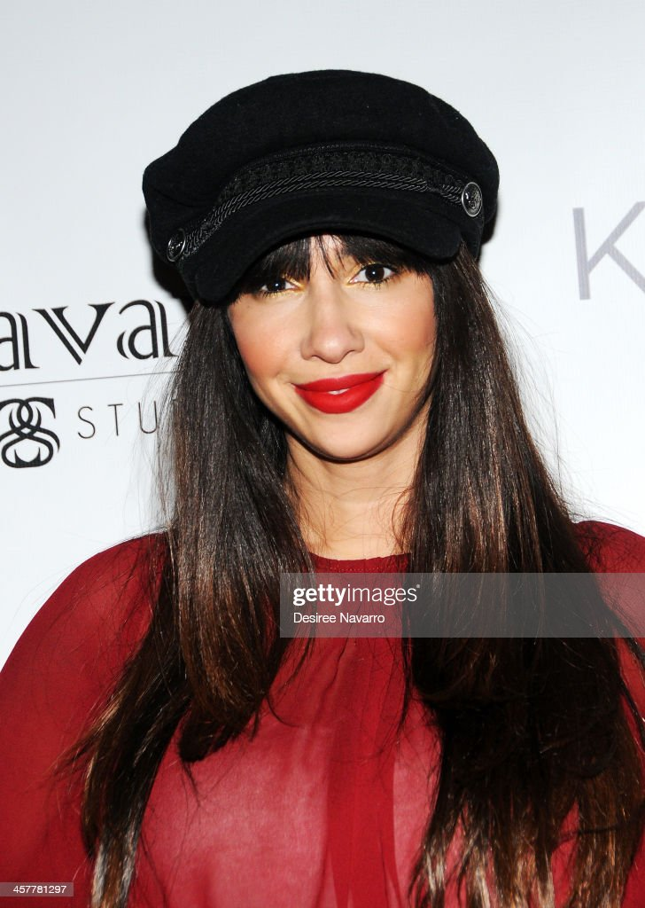 Actress Jackie Cruz attends the 'Orange Is The New Black - My Year In Women's Prison' charity book shopping experience at Carlton Hotel on December 18, 2013 in New York City.