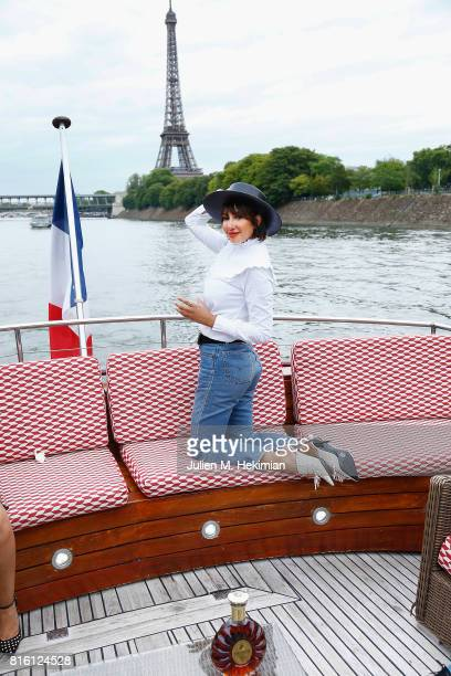 Actress Jackie Cruz is pictured in front of the Eiffel during her cruise on the Seine as part of the Remy Martin XO Dinner with Jackie Cruz on July...