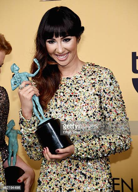 Actress Jackie Cruz winner of Outstanding Performance by an Ensemble in a Comedy Series for 'Orange Is the New Black' poses in the press room at the...
