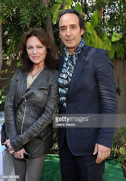 Actress Jacqueline Bisset and composer Alexandre Desplat attend The Consul General Of France Mr Axel Cruau Honors The French Nominees For The 87th...