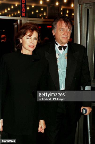 PHOTO 9/10/97 Actress Jacqueline Bisset and unidentified companion attend the movie premiere of 'Hercules' at the Odeon Leicester Square London
