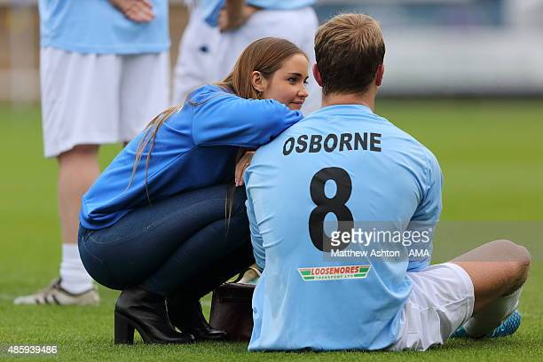 Actress Jacqueline Jossa talks to her partner Dan Osborne during a charity football match in aid of PDSA at Greenhous Meadow home of Shrewsbury Town...