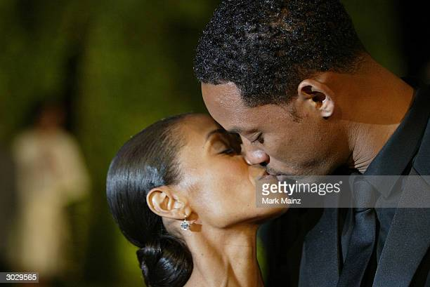 Actress Jada Pinkett Smith and Actor Will Smith attend The 2004 Vanity Fair Oscar Party at Mortons Restaurant February 29 2004 in Hollywood California