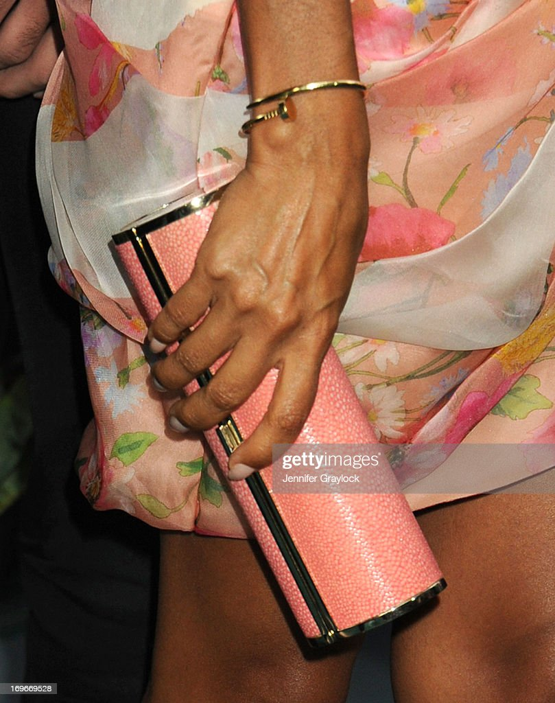 Actress Jada Pinkett Smith (jewelry detail) attends the 'After Earth' premiere at Ziegfeld Theater on May 29, 2013 in New York City.