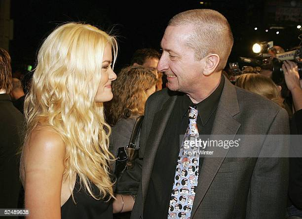 Actress Jaime King and creator Frank Miller arrive at the premiere of 'Sin City' at Mann National Theater on March 28 2005 in Los Angeles California