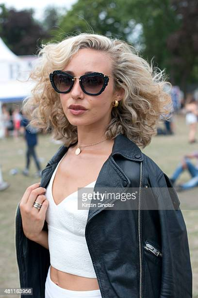 Actress Jamey May wears Miu Miu Sunglasses Zara top and an All Saints jacket at Lovebox 2015 on July 17 2015 in London England