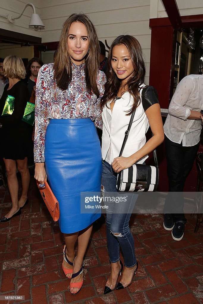 Actress Jamie Chung (R) and Louise Roe attend NYLON Guys and ASOS celebrate April/May cover star Adam Levine at Dominick's Restaurant on April 25, 2013 in Los Angeles, California.