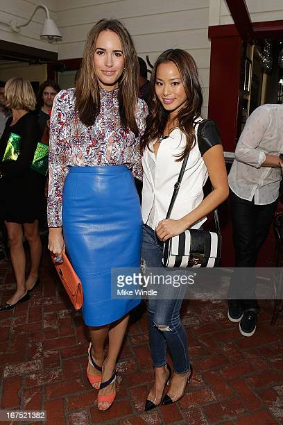 Actress Jamie Chung and Louise Roe attend NYLON Guys and ASOS celebrate April/May cover star Adam Levine at Dominick's Restaurant on April 25 2013 in...
