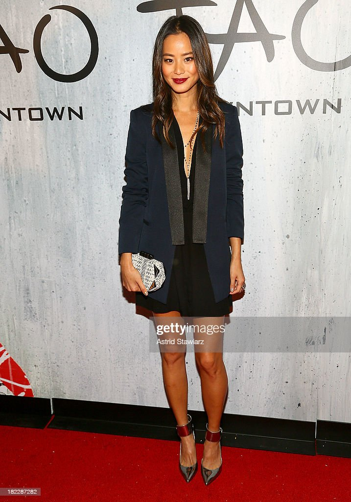 Actress <a gi-track='captionPersonalityLinkClicked' href=/galleries/search?phrase=Jamie+Chung&family=editorial&specificpeople=4145549 ng-click='$event.stopPropagation()'>Jamie Chung</a> attends TAO Downtown Grand Opening on September 28, 2013 in New York City.