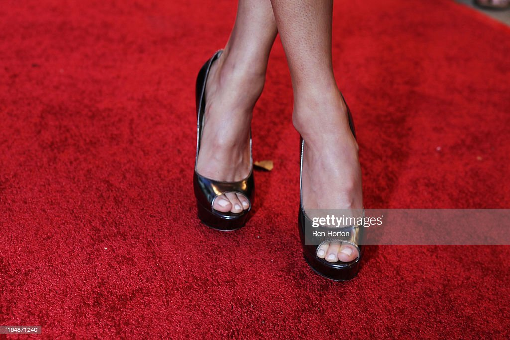 Actress <a gi-track='captionPersonalityLinkClicked' href=/galleries/search?phrase=Jamie+Chung&family=editorial&specificpeople=4145549 ng-click='$event.stopPropagation()'>Jamie Chung</a> (shoe detail) attends the premiere of 'Eden' at Laemmle Music Hall on March 28, 2013 in Beverly Hills, California.