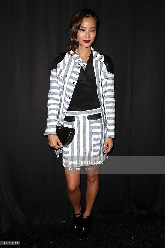 Actress <a gi-track='captionPersonalityLinkClicked' href=/galleries/search?phrase=Jamie+Chung&family=editorial&specificpeople=4145549 ng-click='$event.stopPropagation()'>Jamie Chung</a> poses backstage at the Rebecca Minkoff Spring 2014 fashion show during Mercedes-Benz Fashion Week at The Theatre at Lincoln Center on September 6, 2013 in New York City.