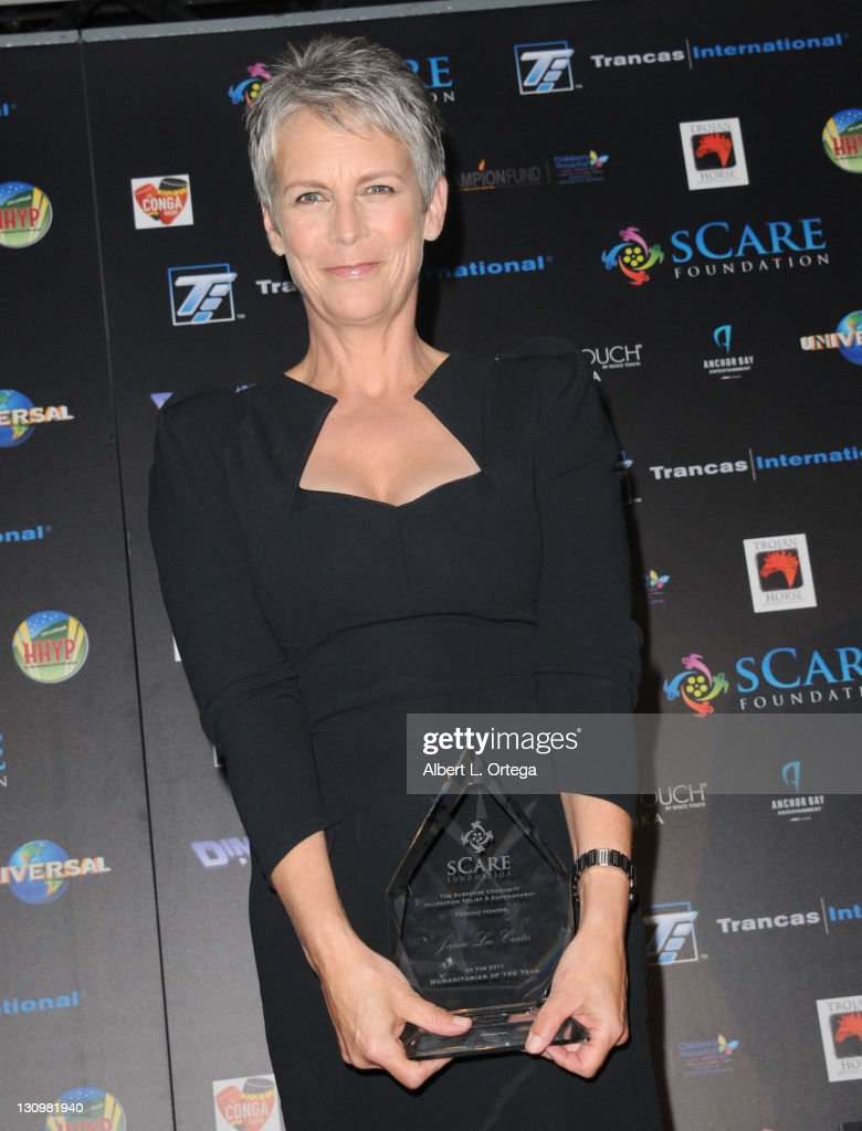 Actress Jamie Lee Curtis accept her award on stage at the sCare Foundation's 1st Annual Halloween Launch Benefit held at The Conga Room at L.A. Live on October 30, 2011 in Los Angeles, California.