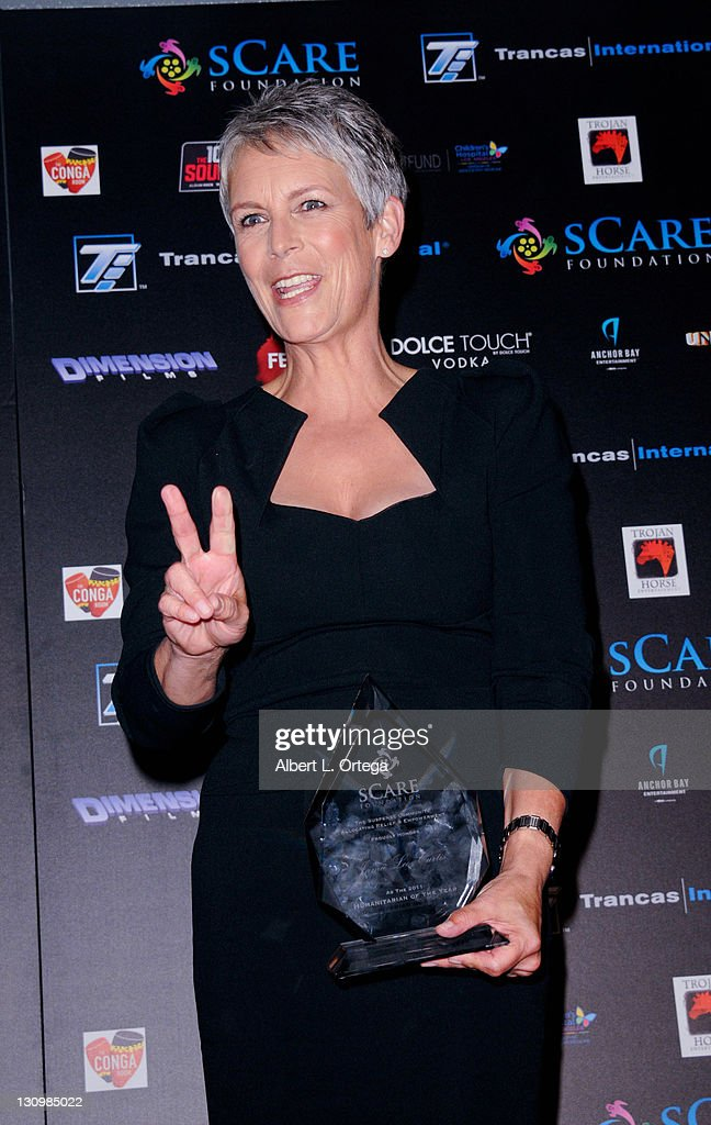 Actress Jamie Lee Curtis accepts her award onstage at the sCare Foundation's 1st Annual Halloween Launch Benefit held at The Conga Room at L.A. Live on October 30, 2011 in Los Angeles, California.