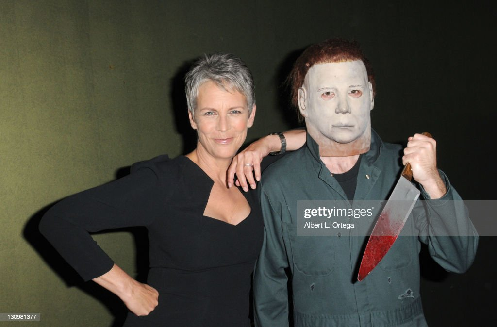 Actress <a gi-track='captionPersonalityLinkClicked' href=/galleries/search?phrase=Jamie+Lee+Curtis&family=editorial&specificpeople=202231 ng-click='$event.stopPropagation()'>Jamie Lee Curtis</a> poses backstage with Michael Myers at the sCare Foundation's 1st Annual Halloween Launch Benefit held at The Conga Room at L.A. Live on October 30, 2011 in Los Angeles, California.