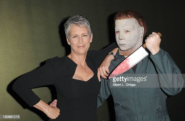 Actress Jamie Lee Curtis poses with Michael Myers backstage at the sCare Foundation's 1st Annual Halloween Launch Benefit held at The Conga Room at...