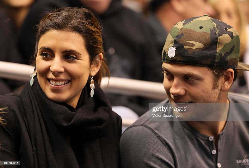 Actress Jamie Lynn Sigler and professional baseball player Cutter Dykstra attend the NHL game between the Columbus Blue Jackets and the Los Angeles Kings at Staples Center on February 15, 2013 in Los Angeles, California. The Kings defeated the Blue Jackets 2-1.