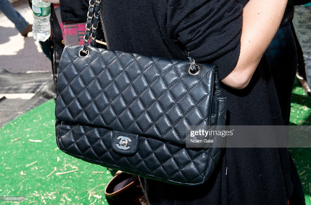 Actress Jamie Lynn Sigler (purse detail) attends 'Be A Farm Hero' at the Flatiron Pedestrian Plaza on April 9, 2014 in New York City.