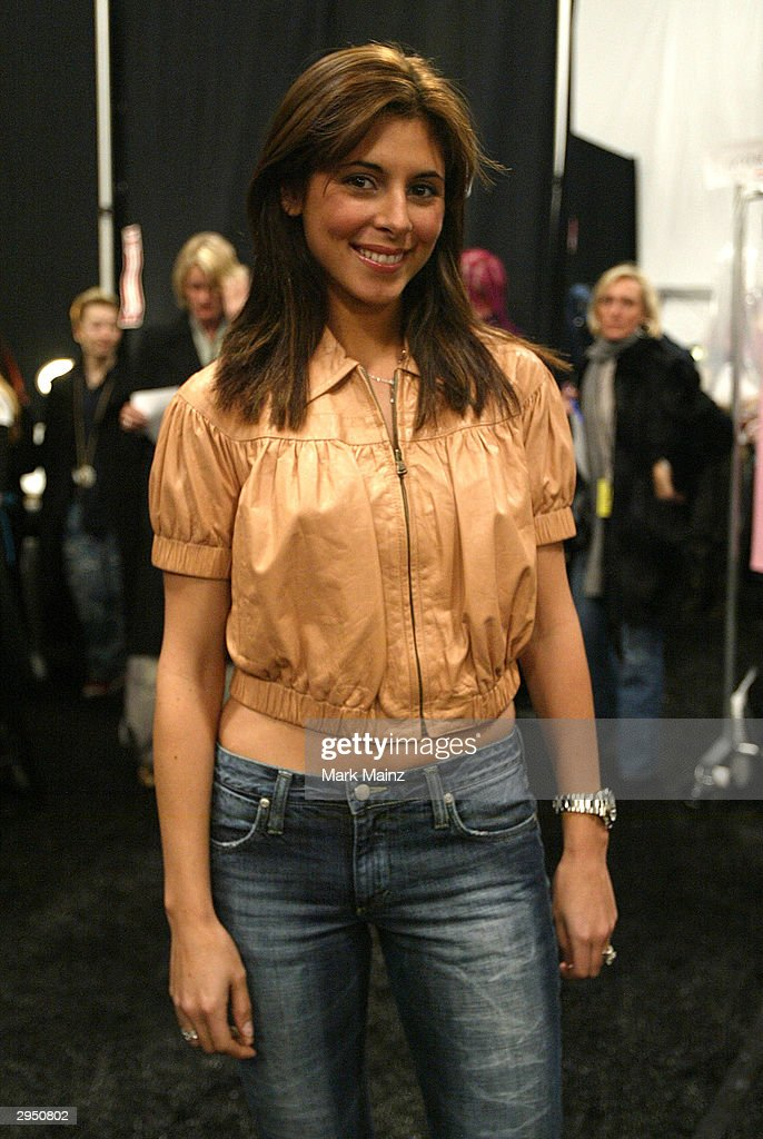 Actress Jamie Lynn-Sigler poses backstage at the Luca Luca Fall 2004 fashion show during the Olympus Fashion Week Fall 2004 at Bryant Park February 8, 2004 in New York City.