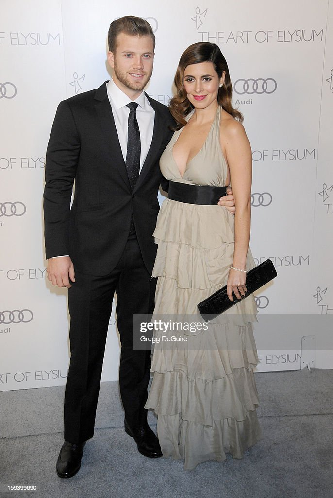 Actress Jamie-Lynn Sigler and Cutter Dykstra arrive at The Art of Elysium's Heaven Gala at 2nd Street Tunnel on January 12, 2013 in Los Angeles, California.