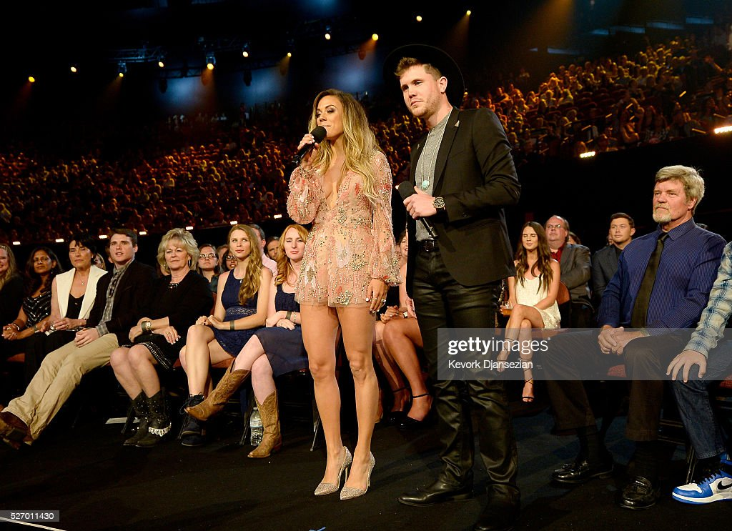 Actress <a gi-track='captionPersonalityLinkClicked' href=/galleries/search?phrase=Jana+Kramer&family=editorial&specificpeople=569861 ng-click='$event.stopPropagation()'>Jana Kramer</a> (L) and singer <a gi-track='captionPersonalityLinkClicked' href=/galleries/search?phrase=Trent+Harmon&family=editorial&specificpeople=15440744 ng-click='$event.stopPropagation()'>Trent Harmon</a> speak during the 2016 American Country Countdown Awards at The Forum on May 1, 2016 in Inglewood, California.