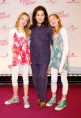 Actress Jana Muenster and twinsister actress Sophia Muenster and actress Hannelore Elsner attend the 'Hanni Nanni World Premiere' at Mathaeser cinema...