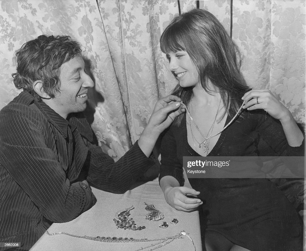 Actress <a gi-track='captionPersonalityLinkClicked' href=/galleries/search?phrase=Jane+Birkin&family=editorial&specificpeople=159385 ng-click='$event.stopPropagation()'>Jane Birkin</a> in Paris with her close friend, actor Serge Gainsbourg. At 'The World's Most Beautiful Jewellery' exhibition by Boucheron, they choose a diamond necklace as a Christmas gift for Jane.