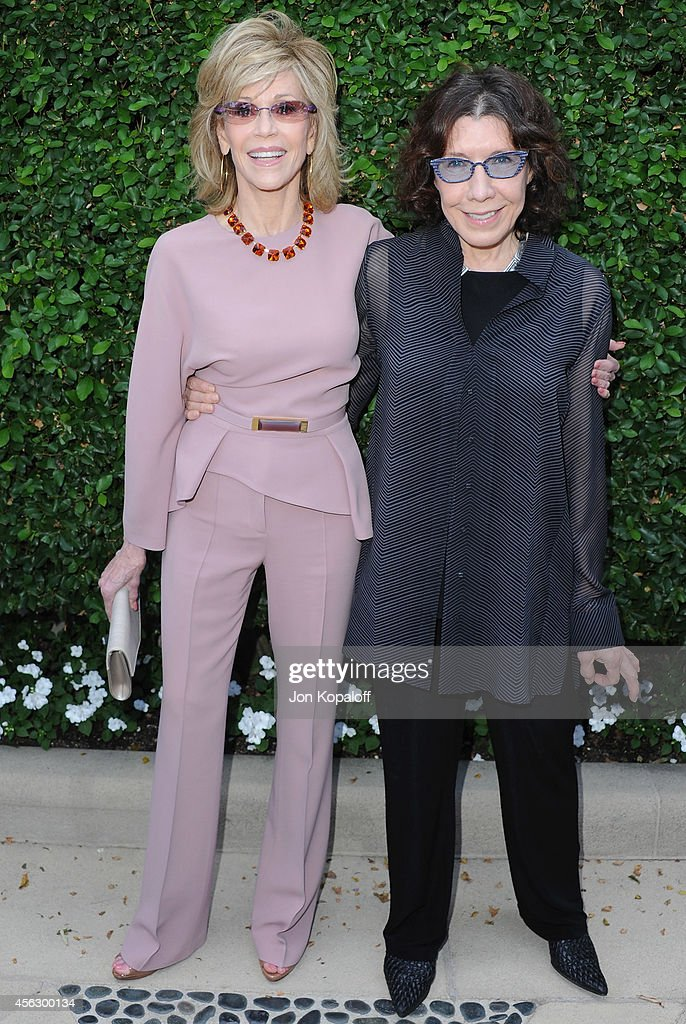 Actress Jane Fonda and actress Lily Tomlin arrive at The Rape Foundation's Annual Brunch at Ron Burkle's Green Acres Estate on September 28, 2014 in Beverly Hills, California.