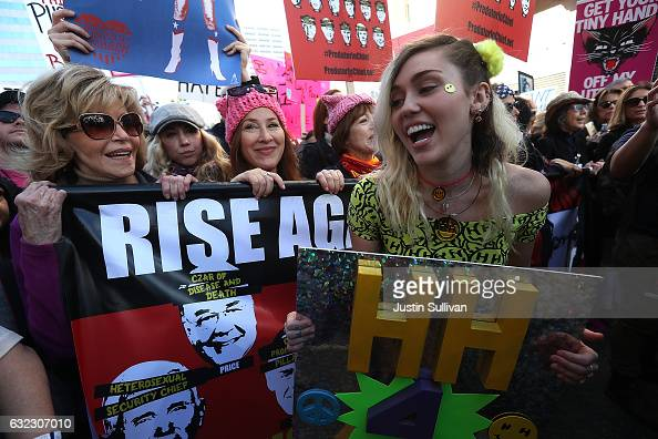 Actress Jane Fonda and singer Miley Cyrus march during the Women's March on January 21 2017 in Los Angeles California Ten of thousands of people took...