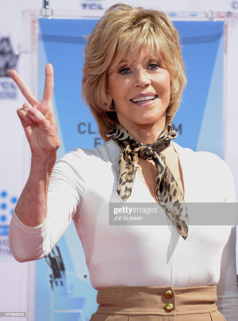 Actress Jane Fonda gives the victory sign during her Handprint/Footprint Ceremony during the 2013 TCM Classic Film Festival at TCL Chinese Theatre on April 27, 2013 in Los Angeles, California.Jane Fonda is an American actress, writer, political activist, former fashion model, and fitness guru. She rose to fame in the 1960s with films such as Barbarella and Cat Ballou. She has won two Academy Awards, an Emmy Award, three Golden Globes and received several other movie awards and nominations during more than 50 years as an actress. After 15 years of retirement, she returned to film in 2005 with Monster-in-Law, followed by Georgia Rule two years later. She also produced and starred in over 20 exercise videos released between 1982 and 1995, and once again in 2010.