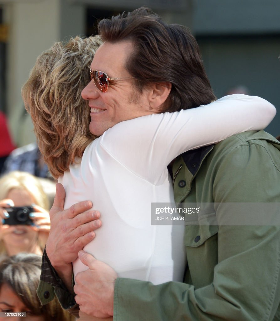 Actress Jane Fonda hugs actor Jim Carrey during her Handprint/Footprint Ceremony during the 2013 TCM Classic Film Festival at TCL Chinese Theatre on April 27, 2013 in Los Angeles. Fonda is an American actress, writer, political activist, former fashion model, and fitness guru. She rose to fame in the 1960s with films such as Barbarella and Cat Ballou. She has won two Academy Awards, an Emmy Award, three Golden Globes and received several other movie awards and nominations during more than 50 years as an actress. After 15 years of retirement, she returned to film in 2005 with Monster-in-Law, followed by Georgia Rule two years later. She also produced and starred in over 20 exercise videos released between 1982 and 1995, and once again in 2010.