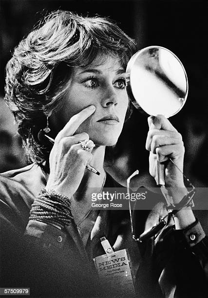 Actress Jane Fonda inspects her makeup in a hand mirror on the 1978 Las Vegas Nevada film set for the 79 movie 'The Electric Horseman' Fonda portrays...
