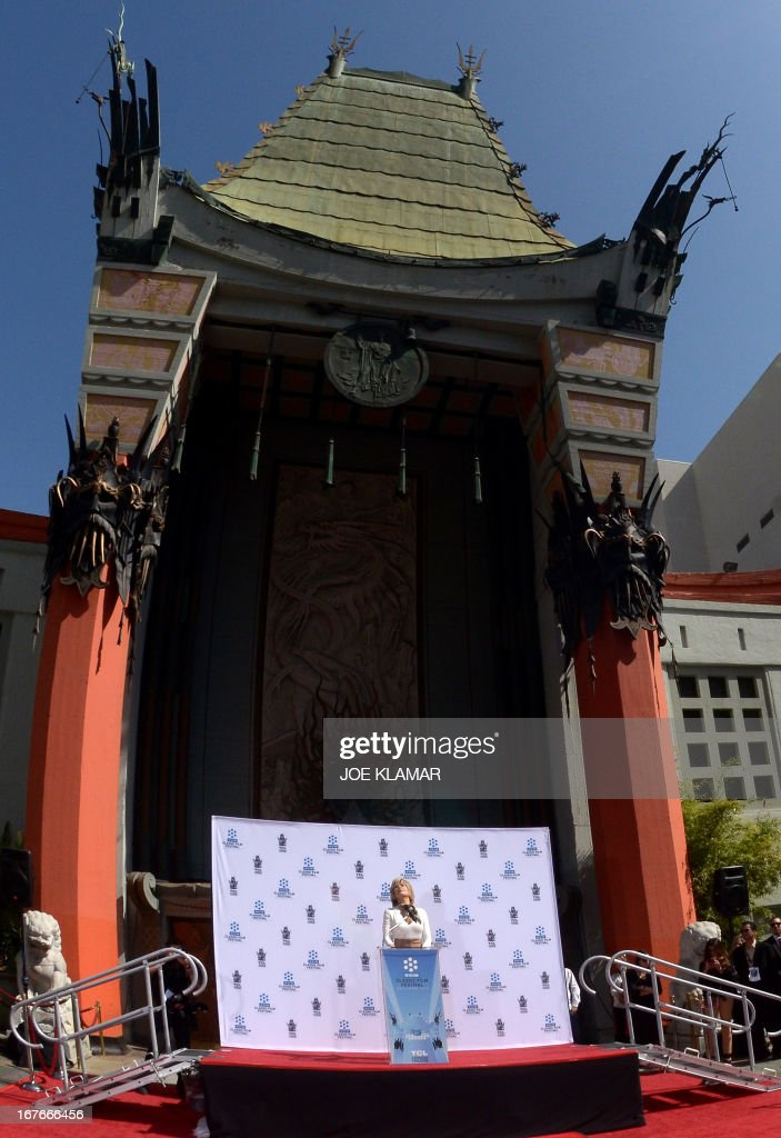 Actress Jane Fonda looks up while speaking about her father, Henry Fonda, during her Handprint/Footprint Ceremony during the 2013 TCM Classic Film Festival at TCL Chinese Theatre on April 27, 2013 in Los Angeles. Fonda is an American actress, writer, political activist, former fashion model, and fitness guru. She rose to fame in the 1960s with films such as Barbarella and Cat Ballou. She has won two Academy Awards, an Emmy Award, three Golden Globes and received several other movie awards and nominations during more than 50 years as an actress. After 15 years of retirement, she returned to film in 2005 with Monster-in-Law, followed by Georgia Rule two years later. She also produced and starred in over 20 exercise videos released between 1982 and 1995, and once again in 2010.