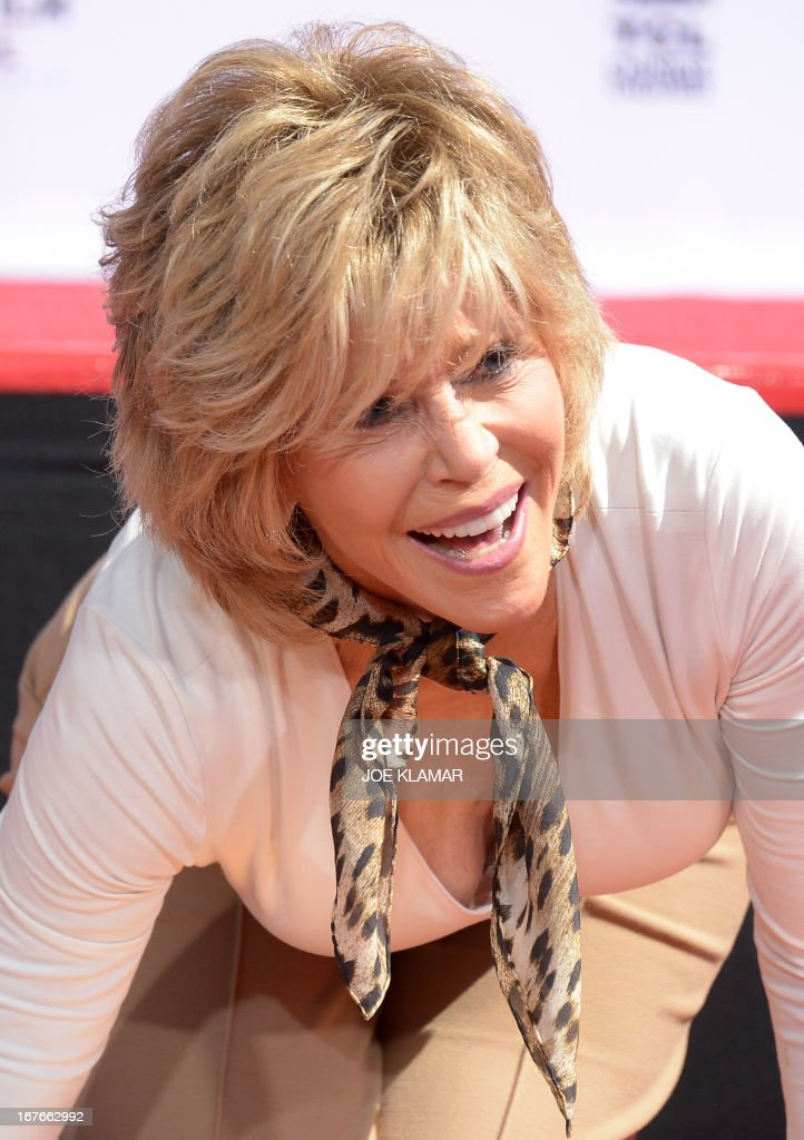 Actress Jane Fonda prints her hands and feet in wet cement during her Handprint/Footprint Ceremony during the 2013 TCM Classic Film Festival at TCL Chinese Theatre on April 27, 2013 in Los Angeles, California.Jane Fonda is an American actress, writer, political activist, former fashion model, and fitness guru. She rose to fame in the 1960s with films such as Barbarella and Cat Ballou. She has won two Academy Awards, an Emmy Award, three Golden Globes and received several other movie awards and nominations during more than 50 years as an actress. After 15 years of retirement, she returned to film in 2005 with Monster-in-Law, followed by Georgia Rule two years later. She also produced and starred in over 20 exercise videos released between 1982 and 1995, and once again in 2010.