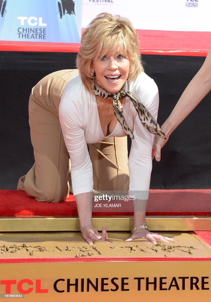 Actress Jane Fonda prints her hands in wet cement during her Handprint/Footprint Ceremony during the 2013 TCM Classic Film Festival at TCL Chinese Theatre on April 27, 2013 in Los Angeles. Fonda is an American actress, writer, political activist, former fashion model, and fitness guru. She rose to fame in the 1960s with films such as Barbarella and Cat Ballou. She has won two Academy Awards, an Emmy Award, three Golden Globes and received several other movie awards and nominations during more than 50 years as an actress. After 15 years of retirement, she returned to film in 2005 with Monster-in-Law, followed by Georgia Rule two years later. She also produced and starred in over 20 exercise videos released between 1982 and 1995, and once again in 2010. AFP PHOTO/JOE KLAMAR