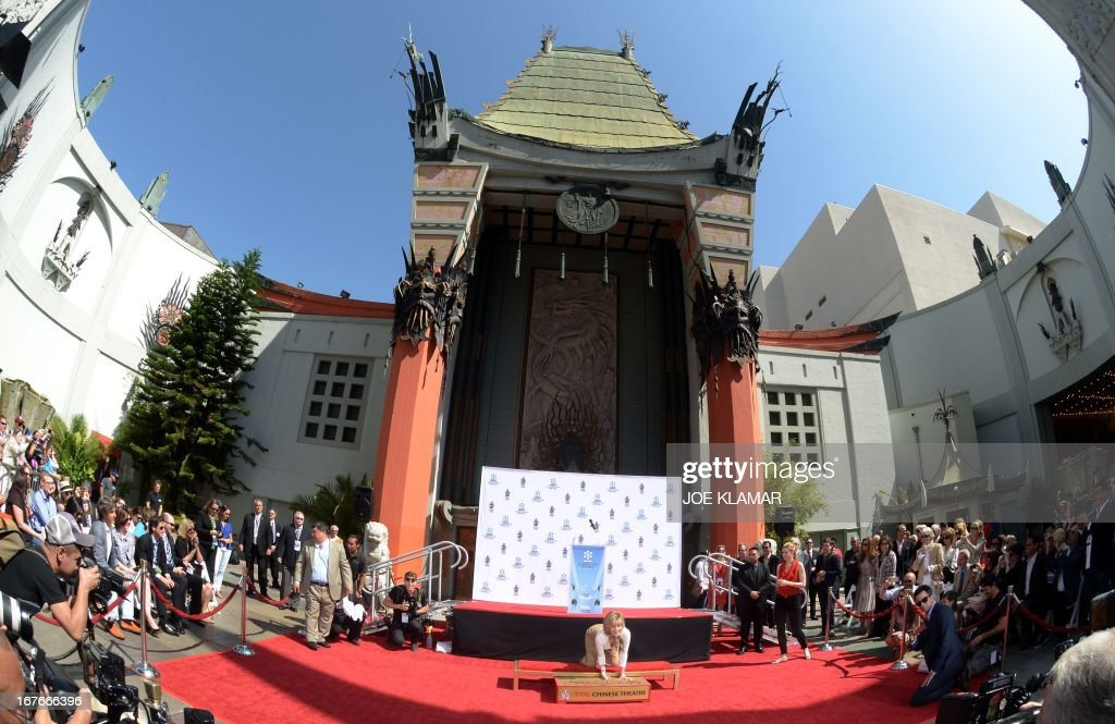 Actress Jane Fonda prints her hands in wet cement during her Handprint/Footprint Ceremony during the 2013 TCM Classic Film Festival at TCL Chinese Theatre on April 27, 2013 in Los Angeles. Fonda is an American actress, writer, political activist, former fashion model, and fitness guru. She rose to fame in the 1960s with films such as Barbarella and Cat Ballou. She has won two Academy Awards, an Emmy Award, three Golden Globes and received several other movie awards and nominations during more than 50 years as an actress. After 15 years of retirement, she returned to film in 2005 with Monster-in-Law, followed by Georgia Rule two years later. She also produced and starred in over 20 exercise videos released between 1982 and 1995, and once again in 2010.