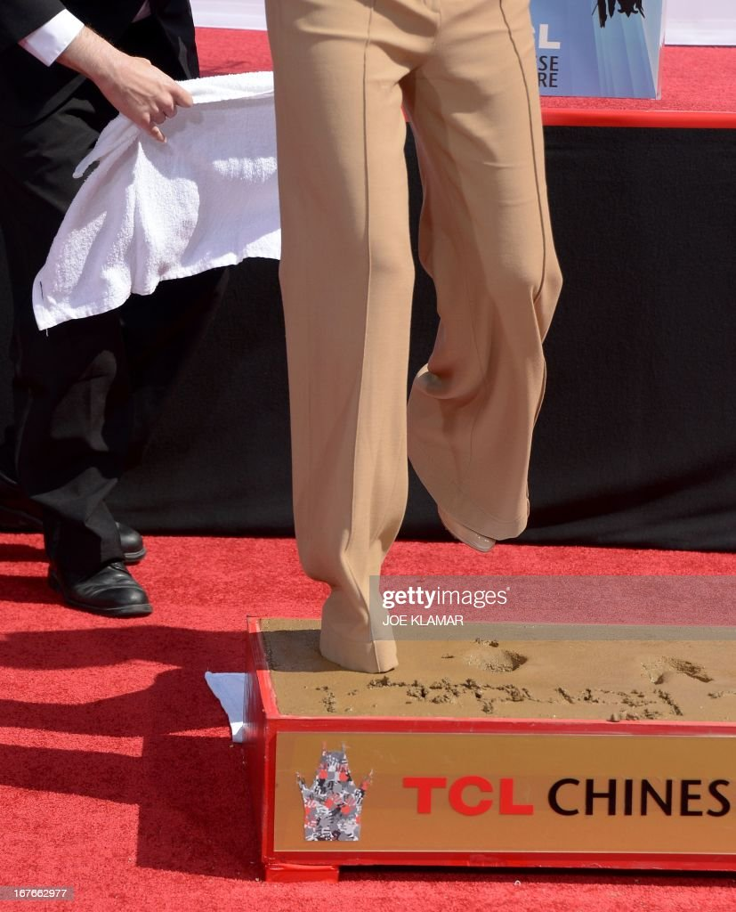 Actress Jane Fonda shows her feet during her Handprint/Footprint Ceremony during the 2013 TCM Classic Film Festival at TCL Chinese Theatre on April 27, 2013 in Los Angeles. Fonda is an American actress, writer, political activist, former fashion model, and fitness guru. She rose to fame in the 1960s with films such as Barbarella and Cat Ballou. She has won two Academy Awards, an Emmy Award, three Golden Globes and received several other movie awards and nominations during more than 50 years as an actress. After 15 years of retirement, she returned to film in 2005 with Monster-in-Law, followed by Georgia Rule two years later. She also produced and starred in over 20 exercise videos released between 1982 and 1995, and once again in 2010.