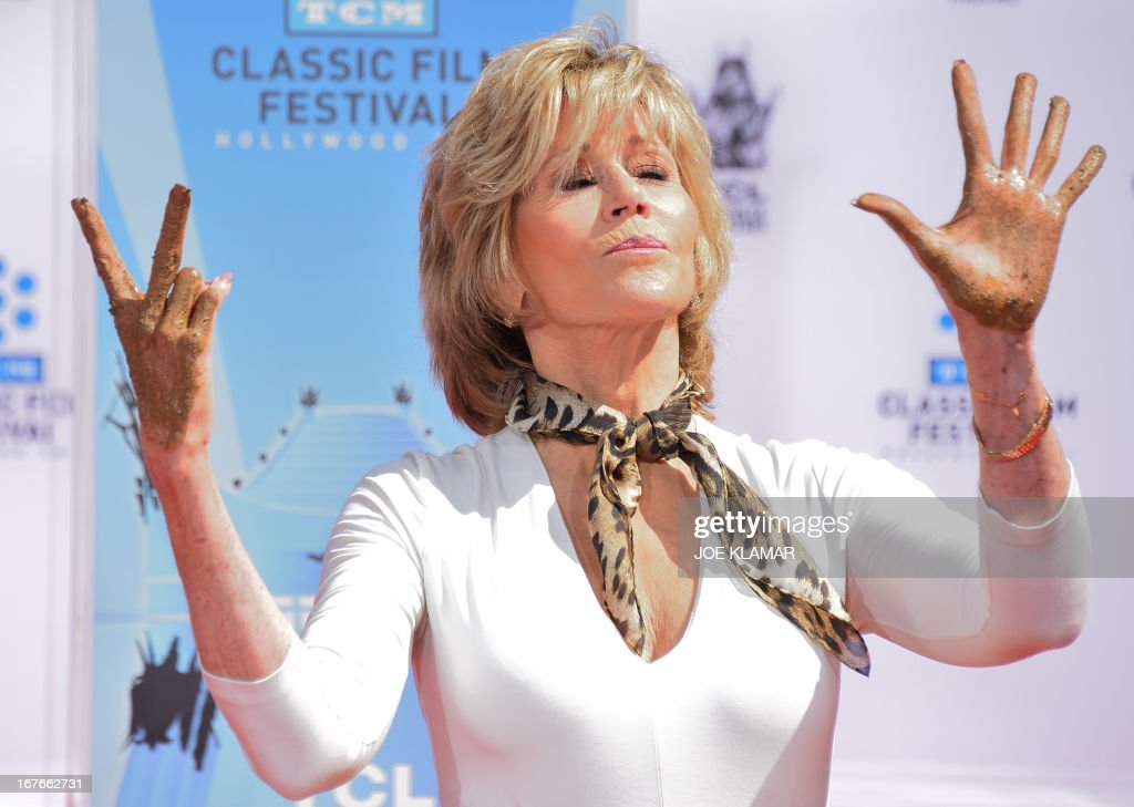 Actress Jane Fonda shows her hands during her Handprint/Footprint Ceremony during the 2013 TCM Classic Film Festival at TCL Chinese Theatre on April 27, 2013 in Los Angeles. Fonda is an American actress, writer, political activist, former fashion model, and fitness guru. She rose to fame in the 1960s with films such as Barbarella and Cat Ballou. She has won two Academy Awards, an Emmy Award, three Golden Globes and received several other movie awards and nominations during more than 50 years as an actress. After 15 years of retirement, she returned to film in 2005 with Monster-in-Law, followed by Georgia Rule two years later. She also produced and starred in over 20 exercise videos released between 1982 and 1995, and once again in 2010.