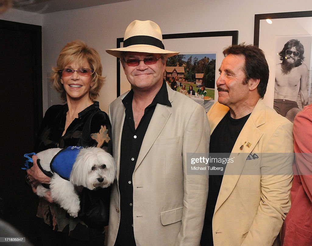 Actress <a gi-track='captionPersonalityLinkClicked' href=/galleries/search?phrase=Jane+Fonda&family=editorial&specificpeople=202174 ng-click='$event.stopPropagation()'>Jane Fonda</a>, singer Mickey Dolenz and guest attend an exhibition of photographer Pattie Boyd's photographs entitled 'Pattie Boyd: Newly Discovered' at Morrison Hotel Gallery on June 28, 2013 in West Hollywood, California.