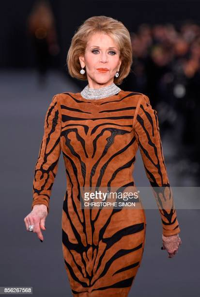 US actress Jane Fonda takes part in the L'Oreal fashion on the sidelines of the Paris Fashion Week on October 1 on a catwalk set up on the...
