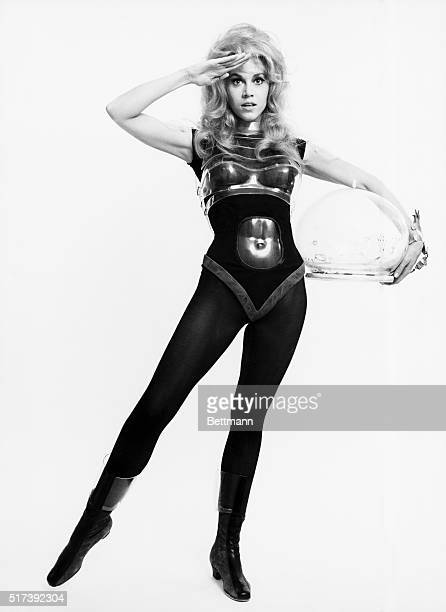 Actress Jane Fonda wearing a form fitted costume including a bodysuit tights molded breast plate and clear plastic helmet in a publicity handout for...