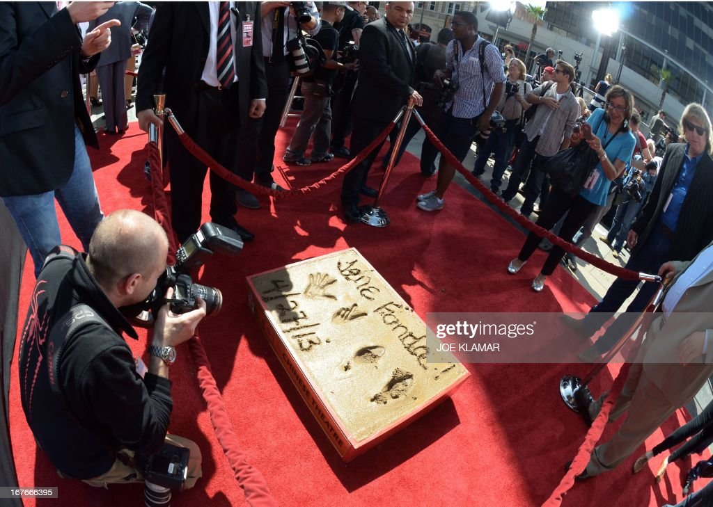 Actress Jane Fonda's cement plaque is seen after her Handprint/Footprint Ceremony during the 2013 TCM Classic Film Festival at TCL Chinese Theatre on April 27, 2013 in Los Angeles. Fonda is an American actress, writer, political activist, former fashion model, and fitness guru. She rose to fame in the 1960s with films such as Barbarella and Cat Ballou. She has won two Academy Awards, an Emmy Award, three Golden Globes and received several other movie awards and nominations during more than 50 years as an actress. After 15 years of retirement, she returned to film in 2005 with Monster-in-Law, followed by Georgia Rule two years later. She also produced and starred in over 20 exercise videos released between 1982 and 1995, and once again in 2010.