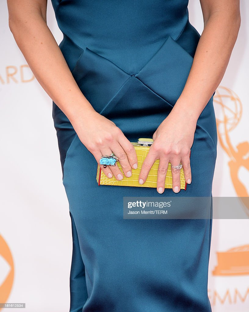 Actress Jane Krakowski (handbag and jewelry detail - Judith Leiber Couture Jellybean Crocodile Rectangle Clutch in Chartreuse) arrives at the 65th Annual Primetime Emmy Awards held at Nokia Theatre L.A. Live on September 22, 2013 in Los Angeles, California.