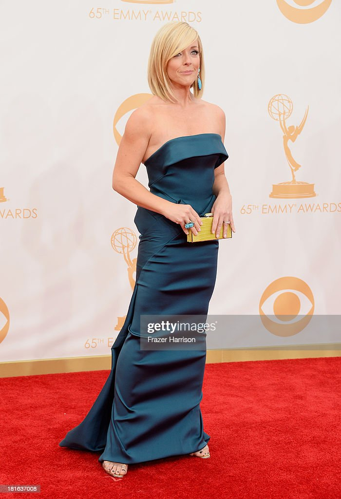 Actress Jane Krakowski (with Judith Leiber Couture Jellybean Crocodile Rectangle Clutch in Chartreuse) arrives at the 65th Annual Primetime Emmy Awards held at Nokia Theatre L.A. Live on September 22, 2013 in Los Angeles, California.