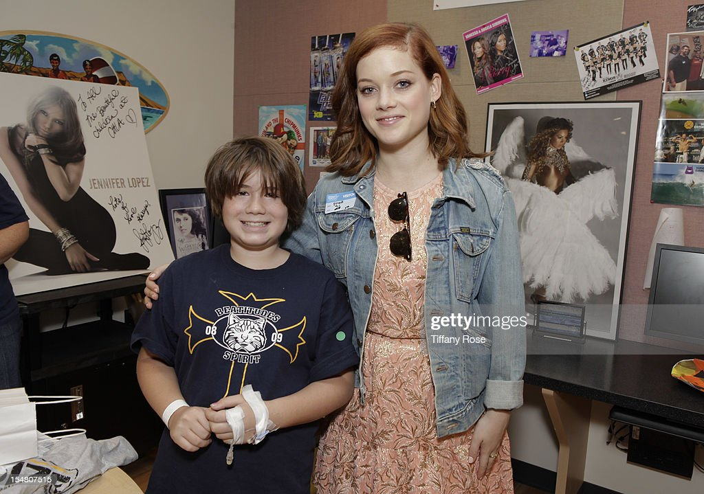 Actress Jane Levy poses with a patientat 'Fun Size' Special Screening At Children's Hospital Los Angeles at Childrens Hospital Of Los Angeles on...